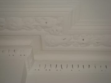 cornice clogged with paint