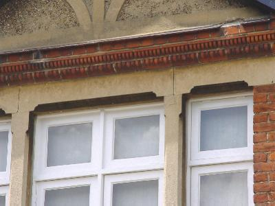 unpainted stucco window lintels